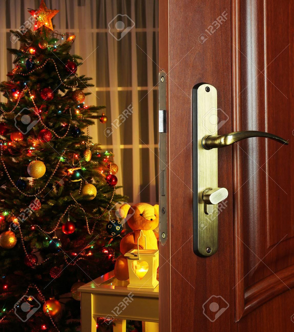 Christmas Door.Open Door With Decorated Christmas Tree In Room