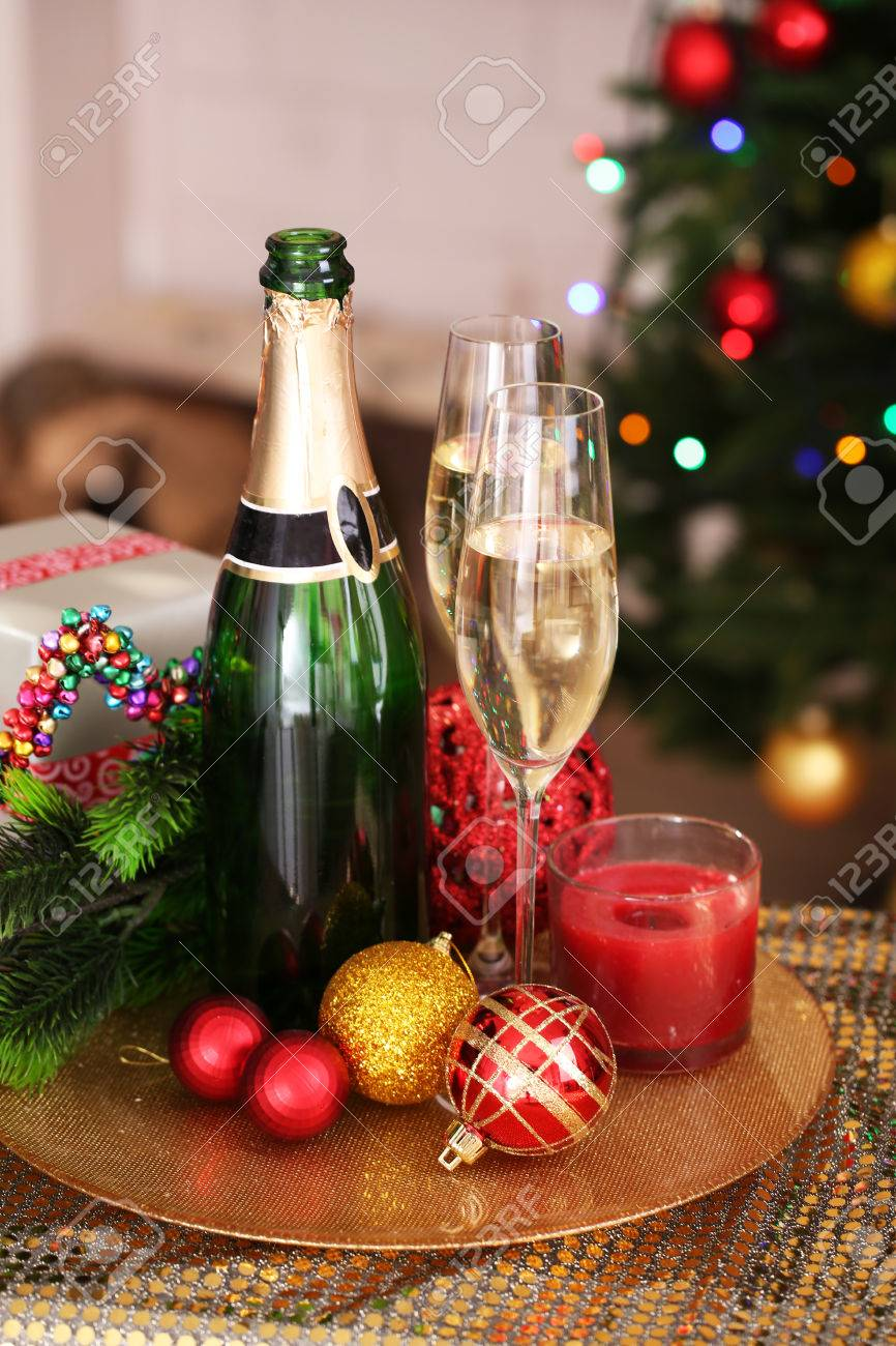 Champagne Bottle Decoration Christmas Decorations And Champagne Bottle And Glasses On Bright