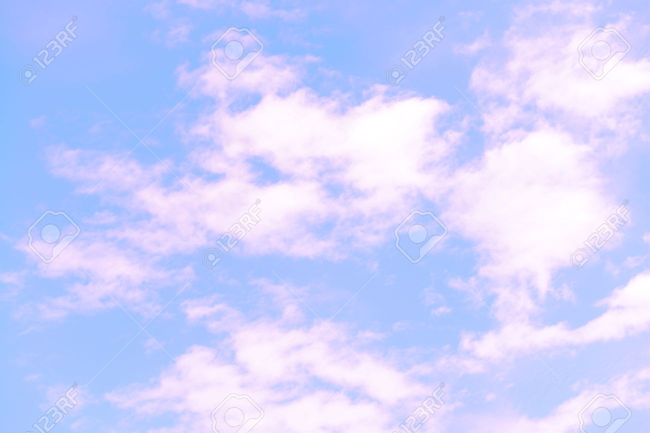 blue sky background with pink clouds stock photo picture and