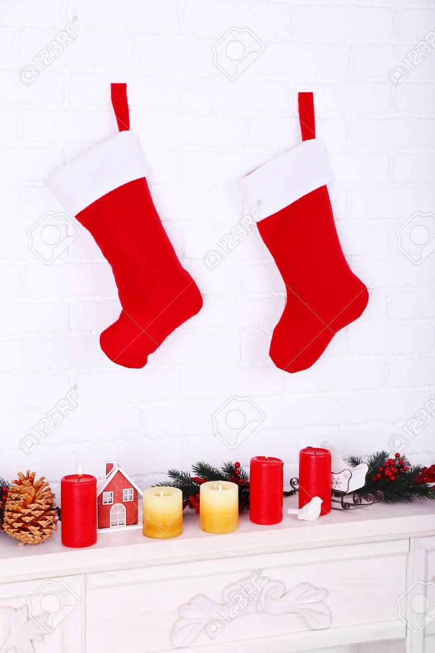 Christmas Socks Hanging On Wall Above Fireplace