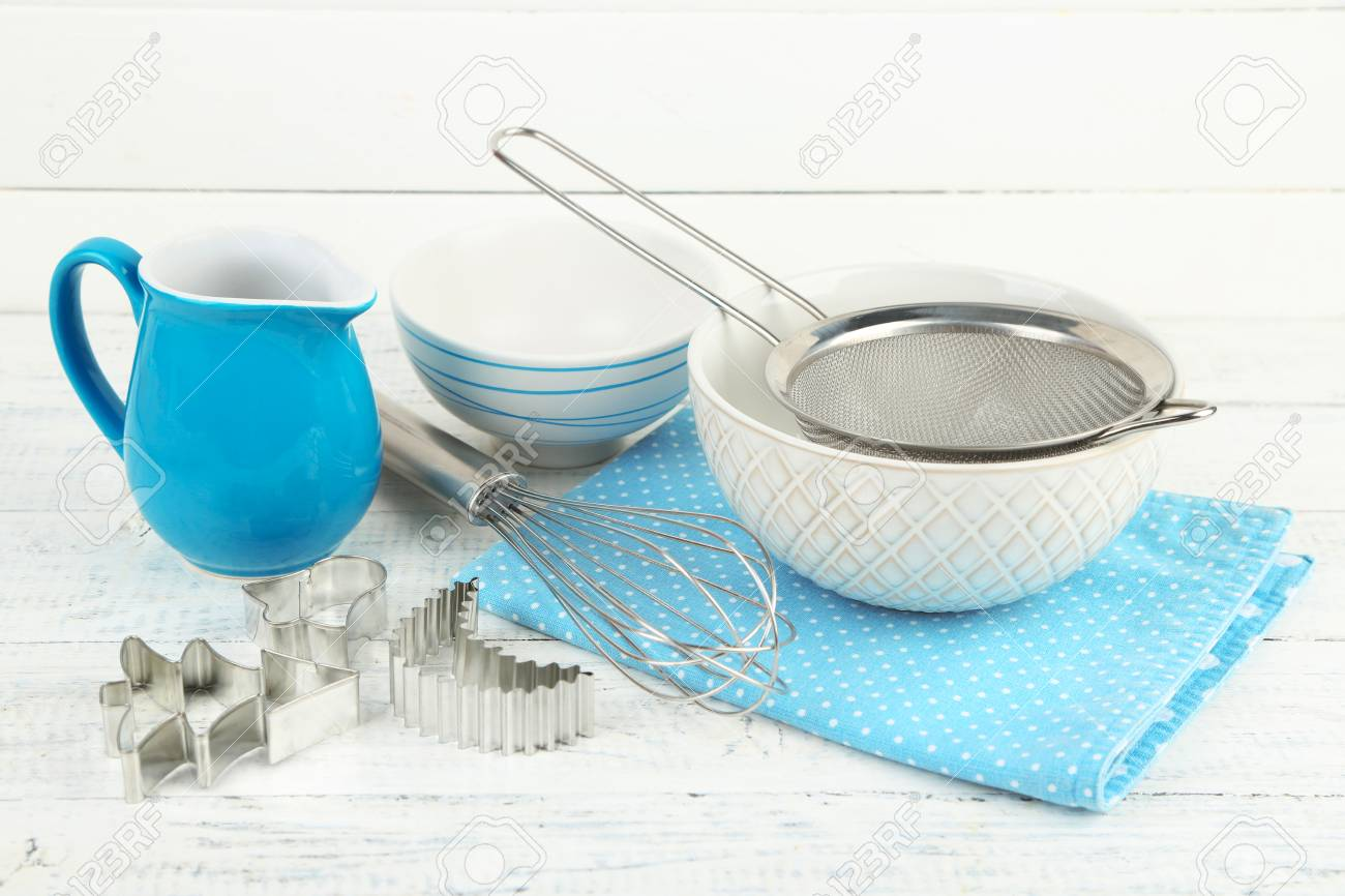 Kitchen Utensils For Baking On Color Wooden Background Stock Photo ...