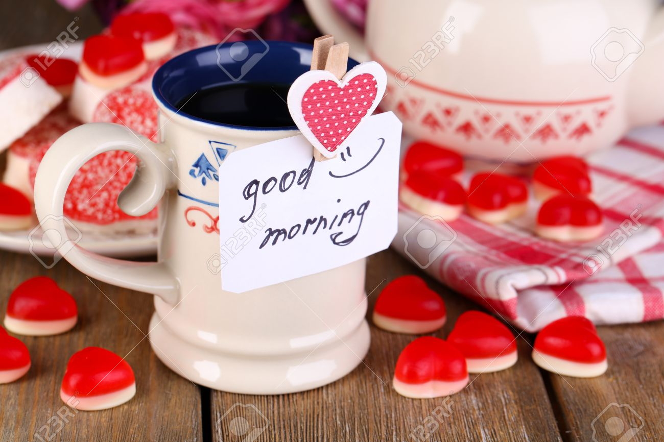 Cup Of Tea With Card That Says Good Morning On Table Close Up Stock