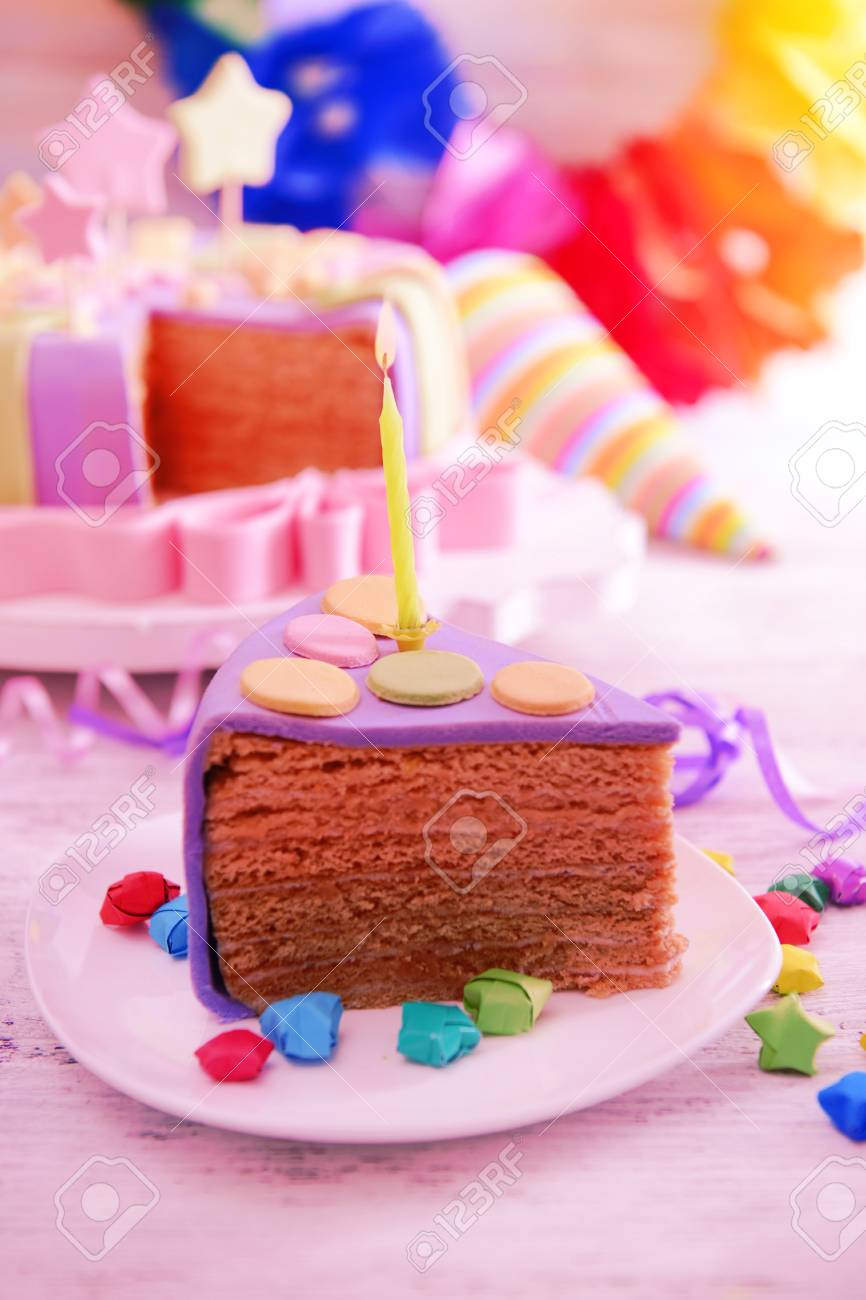 Delicious Piece Of Birthday Cake On Table On Bright Background Stock
