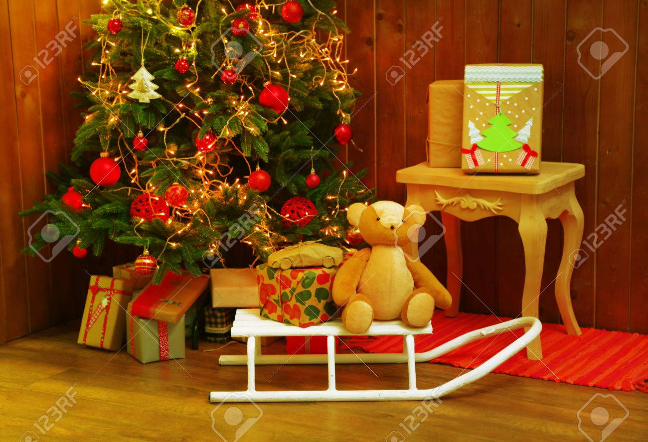 Decorated Christmas Living Room On Wooden Wall Background Stock Photo