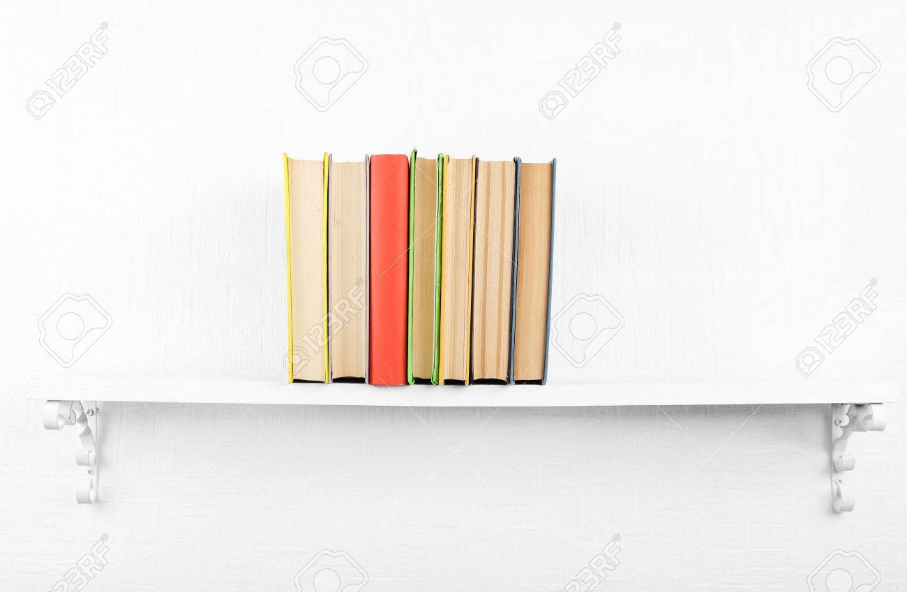Old Books On Bookshelf White Wall Background Stock Photo