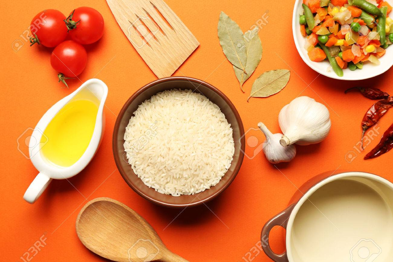 Food Ingredients And Kitchen Utensils For Cooking On Orange Background  Stock Photo   38217143