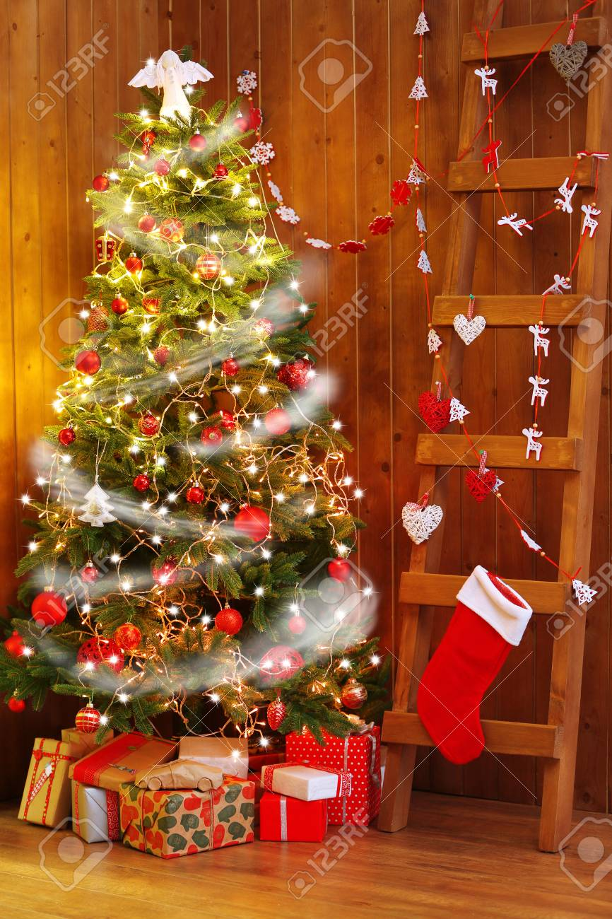 decorated christmas tree and ladder on wooden wall background stock photo 42396892