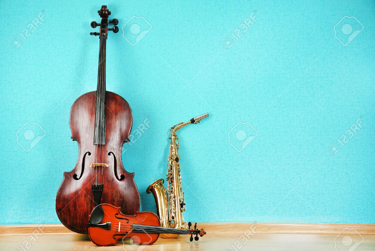 Musical instruments on turquoise wallpaper background - 45177248