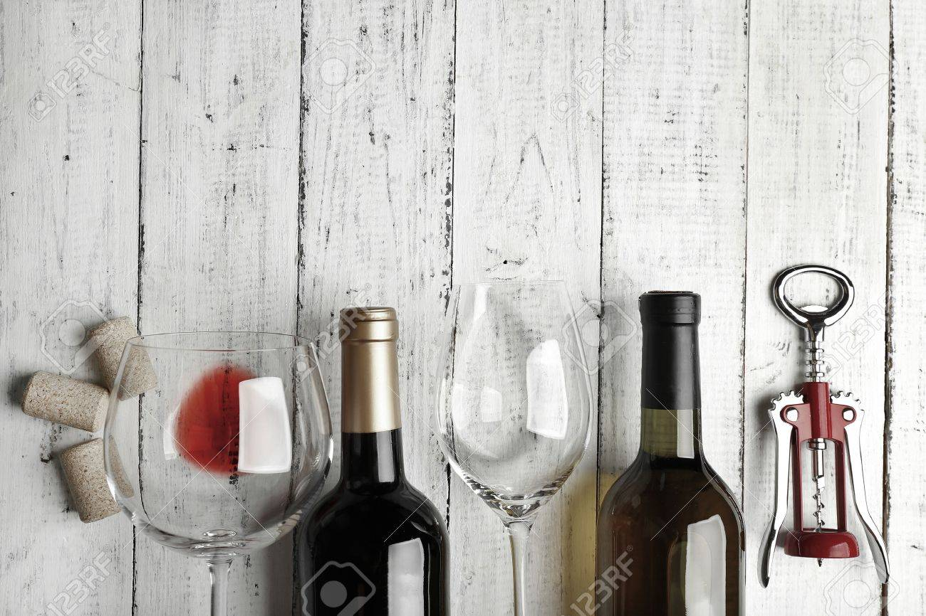 Attractive Bottles Of Wine, Glass And Corkscrew On Wooden Table, Black And White Retro  Stylization