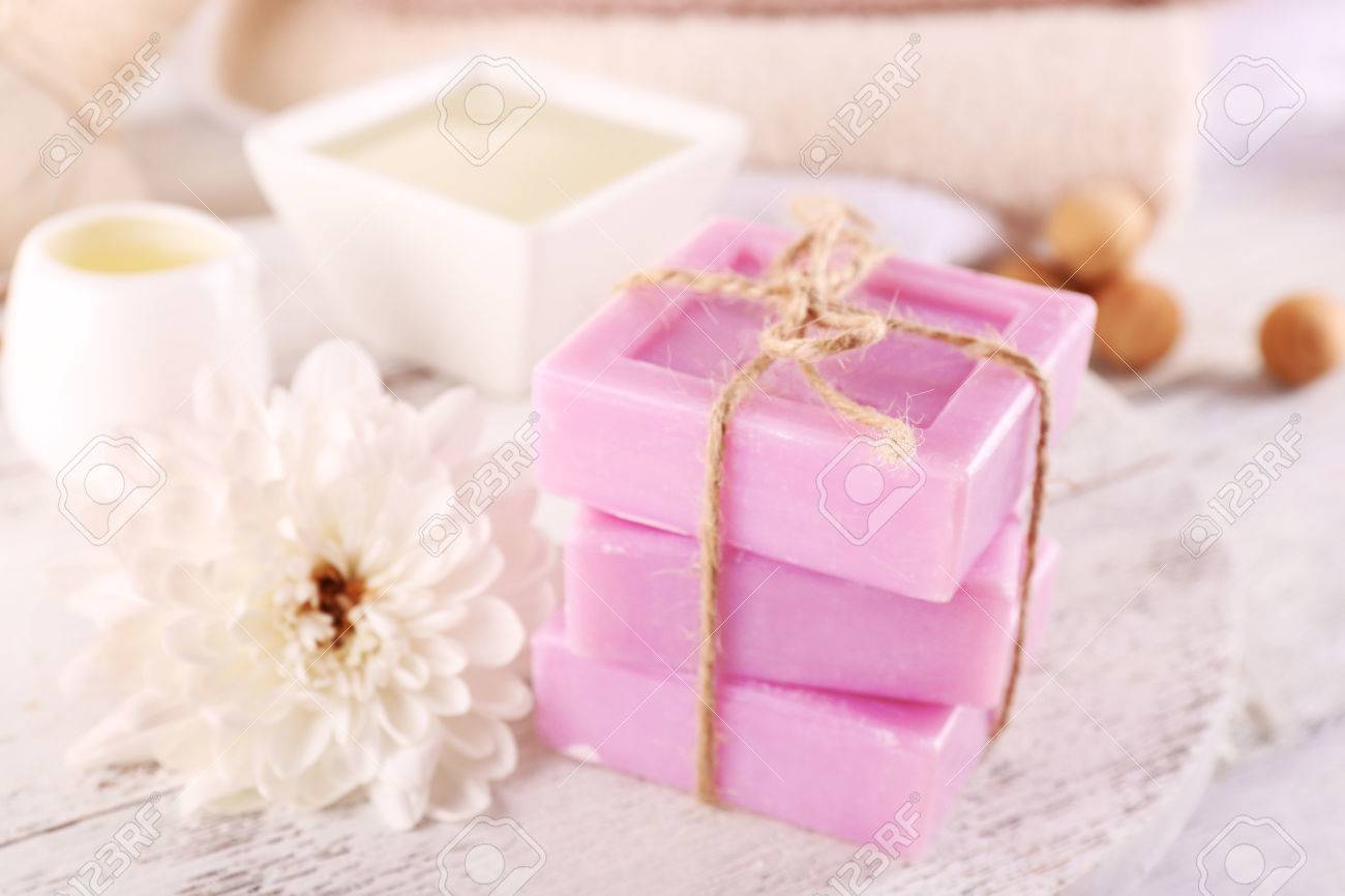 Stack Of Tied Spa Soap On Wooden Table, Closeup Stock Photo, Picture ...