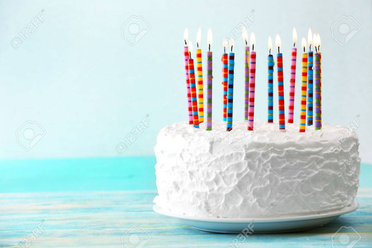 Birthday Cake With Candles On Light Background Stock Photo Picture