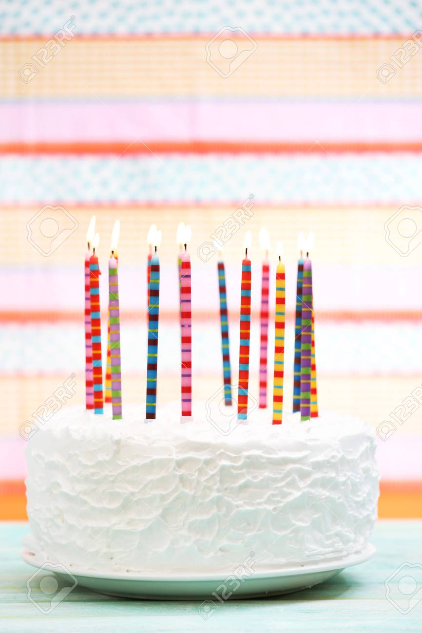 Birthday Cake With Candles On Colorful Striped Background Stock