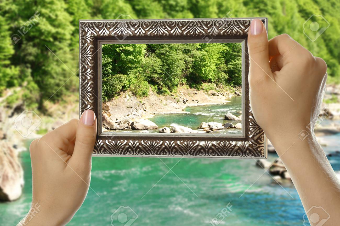 woman hands holding empty frame on nature background stock photo picture and royalty free image image 47445053 123rf com
