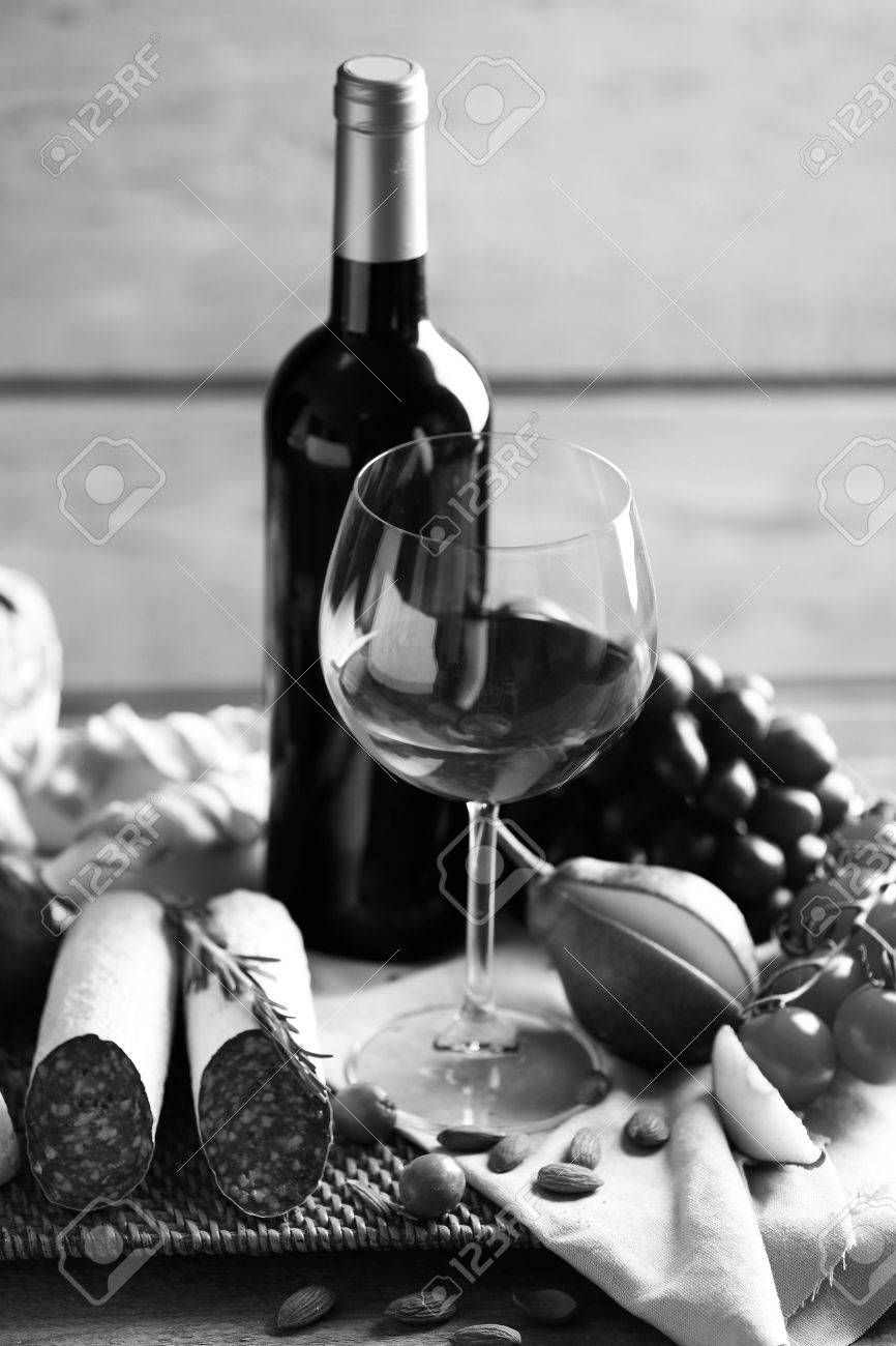 Still life with various types of italian food and wine black and white retro stylization