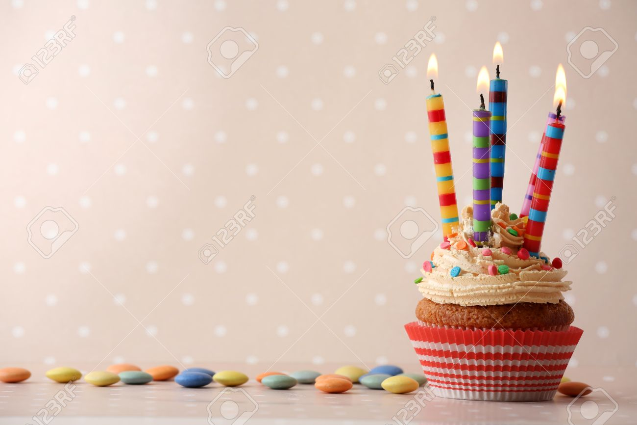 Birthday Cupcake With Candles On Color Background Stock Photo 48820157