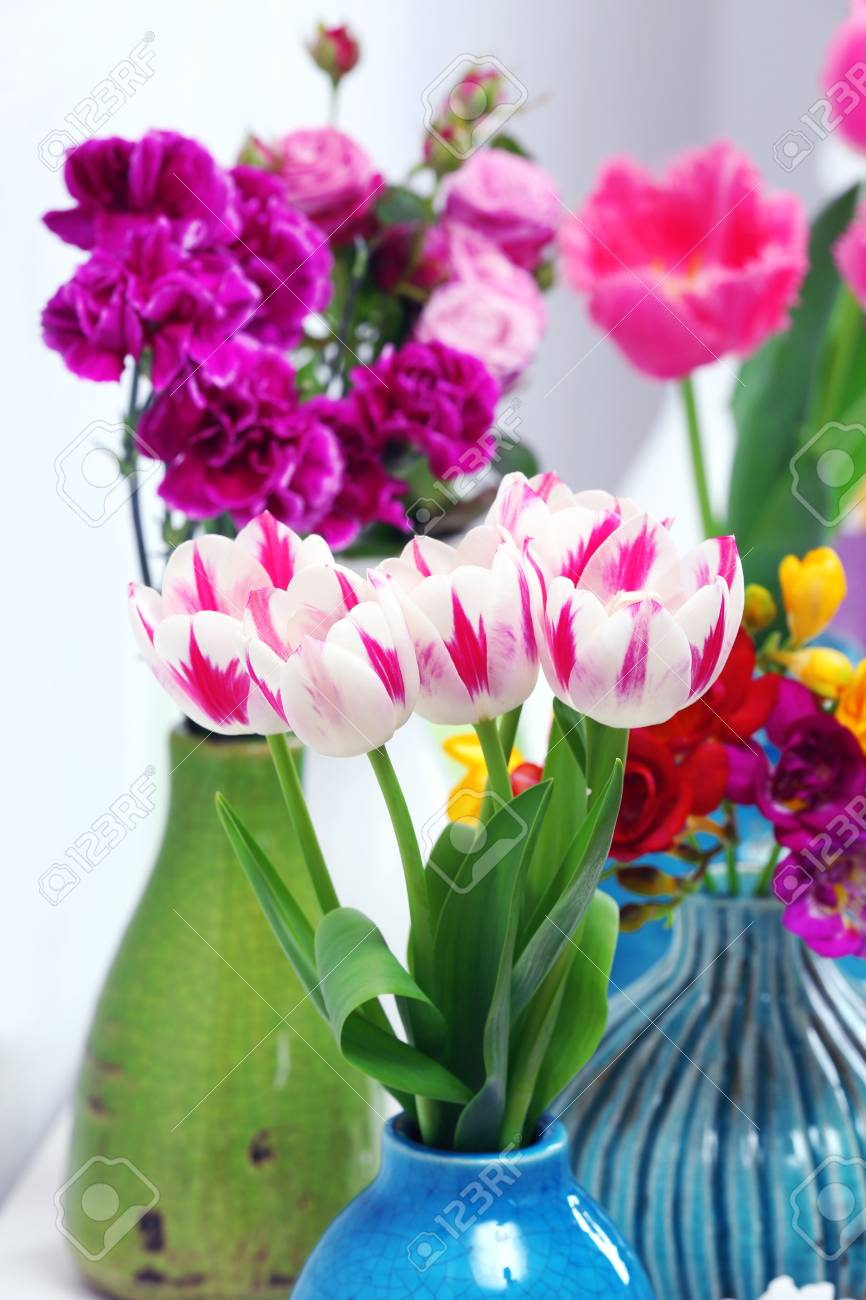 Different beautiful flowers in vases close up stock photo picture different beautiful flowers in vases close up stock photo 49618955 izmirmasajfo