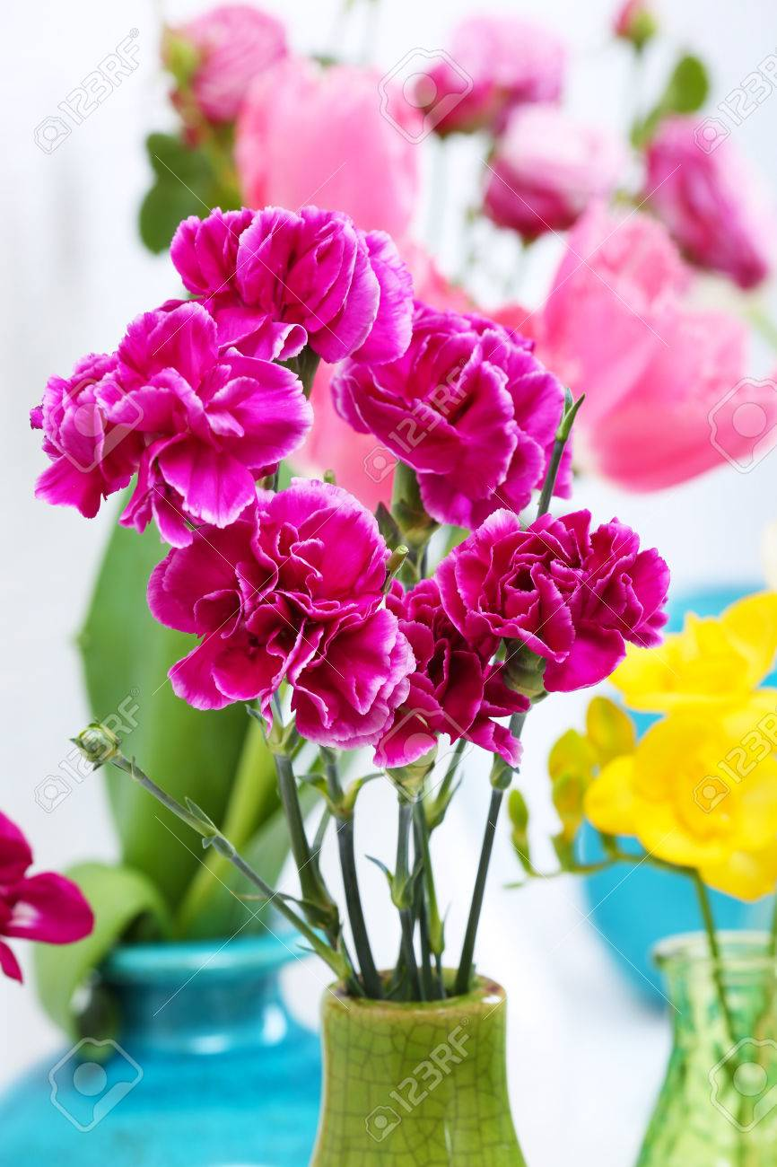 Different beautiful flowers in vases close up stock photo picture different beautiful flowers in vases close up stock photo 49619451 izmirmasajfo