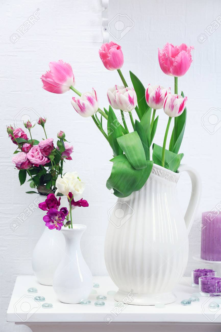 Beautiful composition with different flowers in vases on wall beautiful composition with different flowers in vases on wall background stock photo 49619990 izmirmasajfo