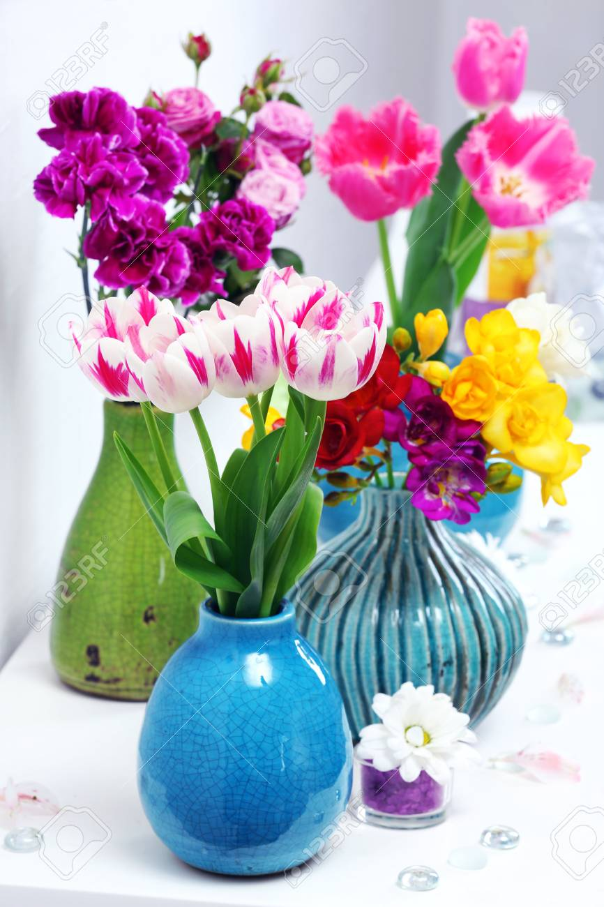 Different beautiful flowers in vases on table close up stock photo different beautiful flowers in vases on table close up stock photo 49621382 izmirmasajfo