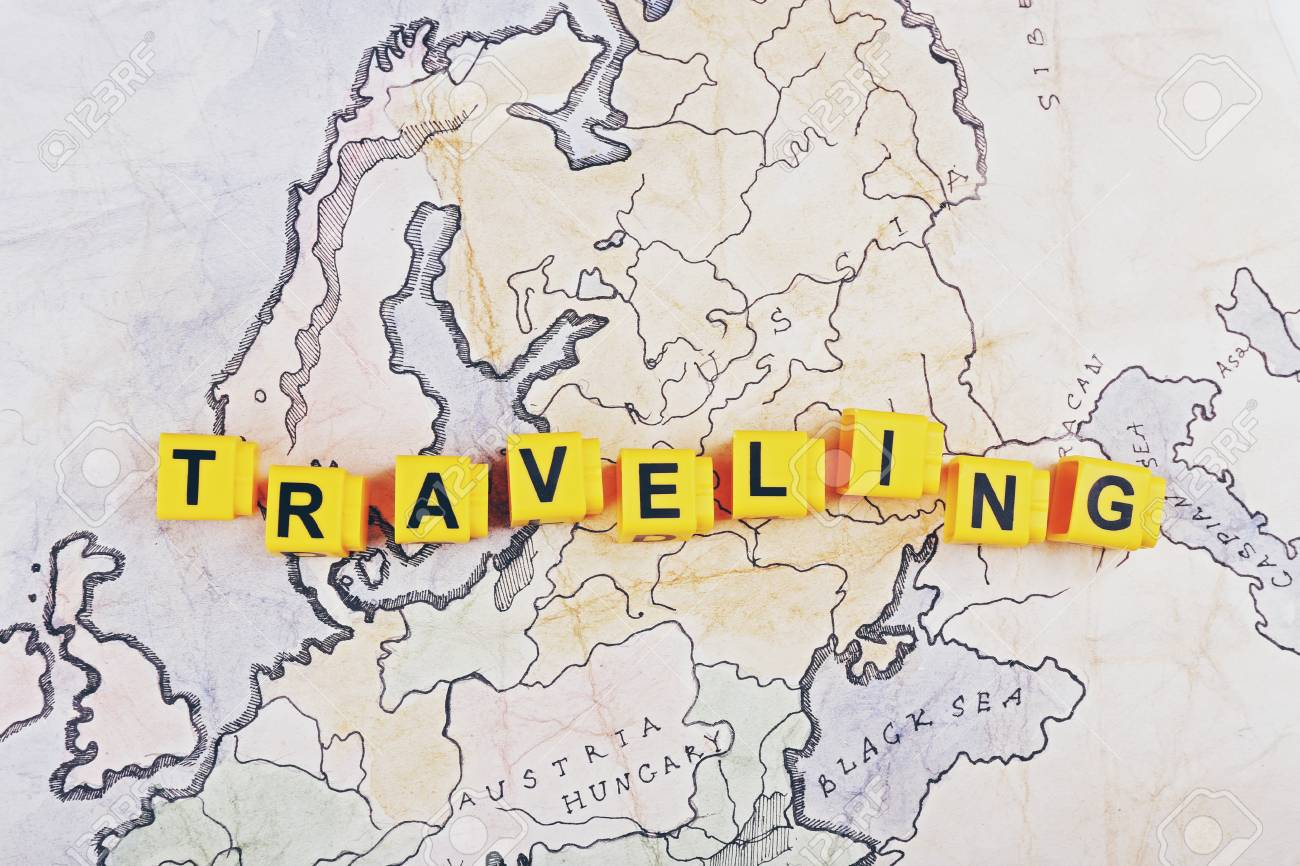 word traveling on world map background stock photo picture and