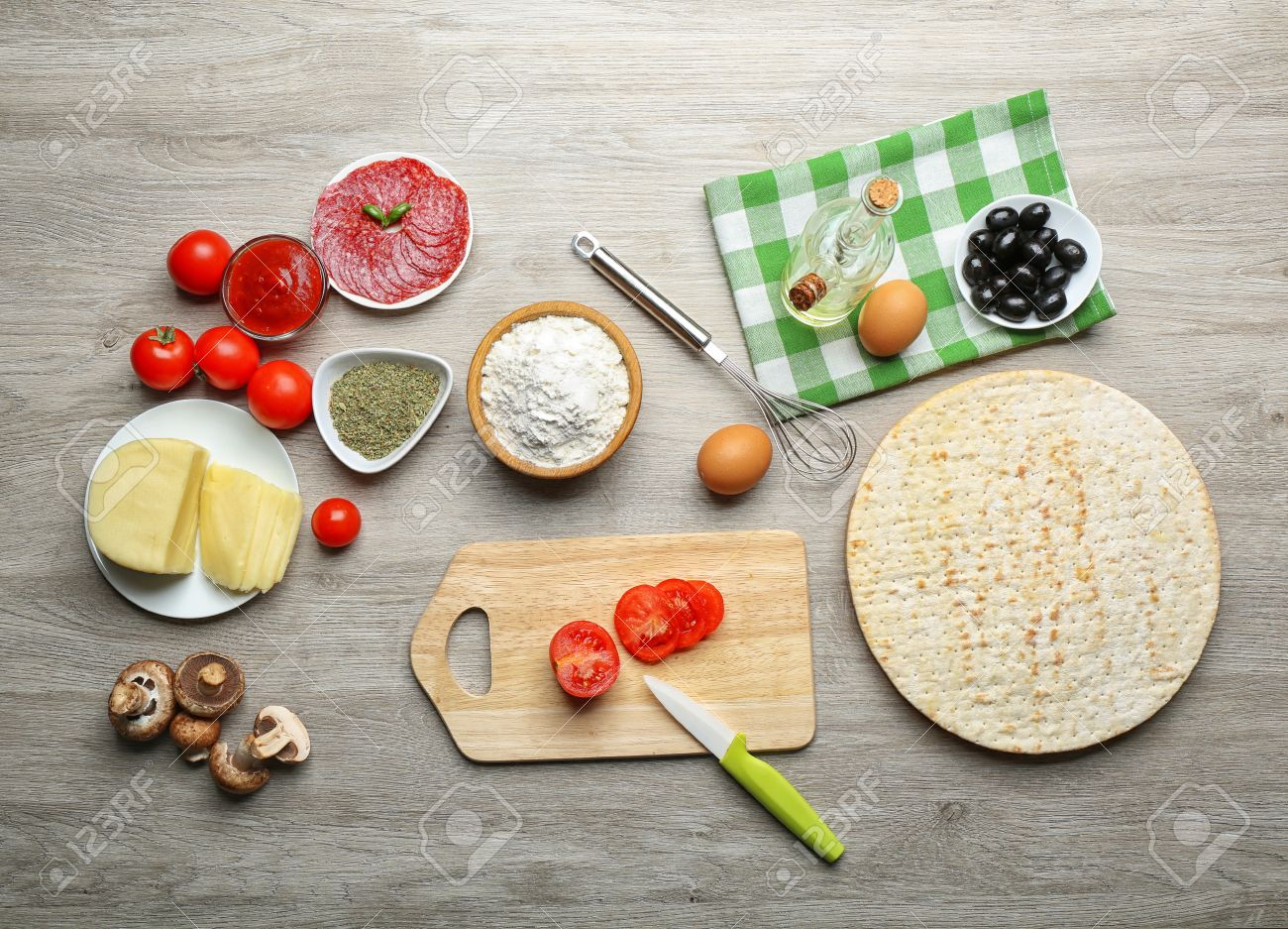 Table Top View ingredients for cooking pizza on wooden table, top view stock