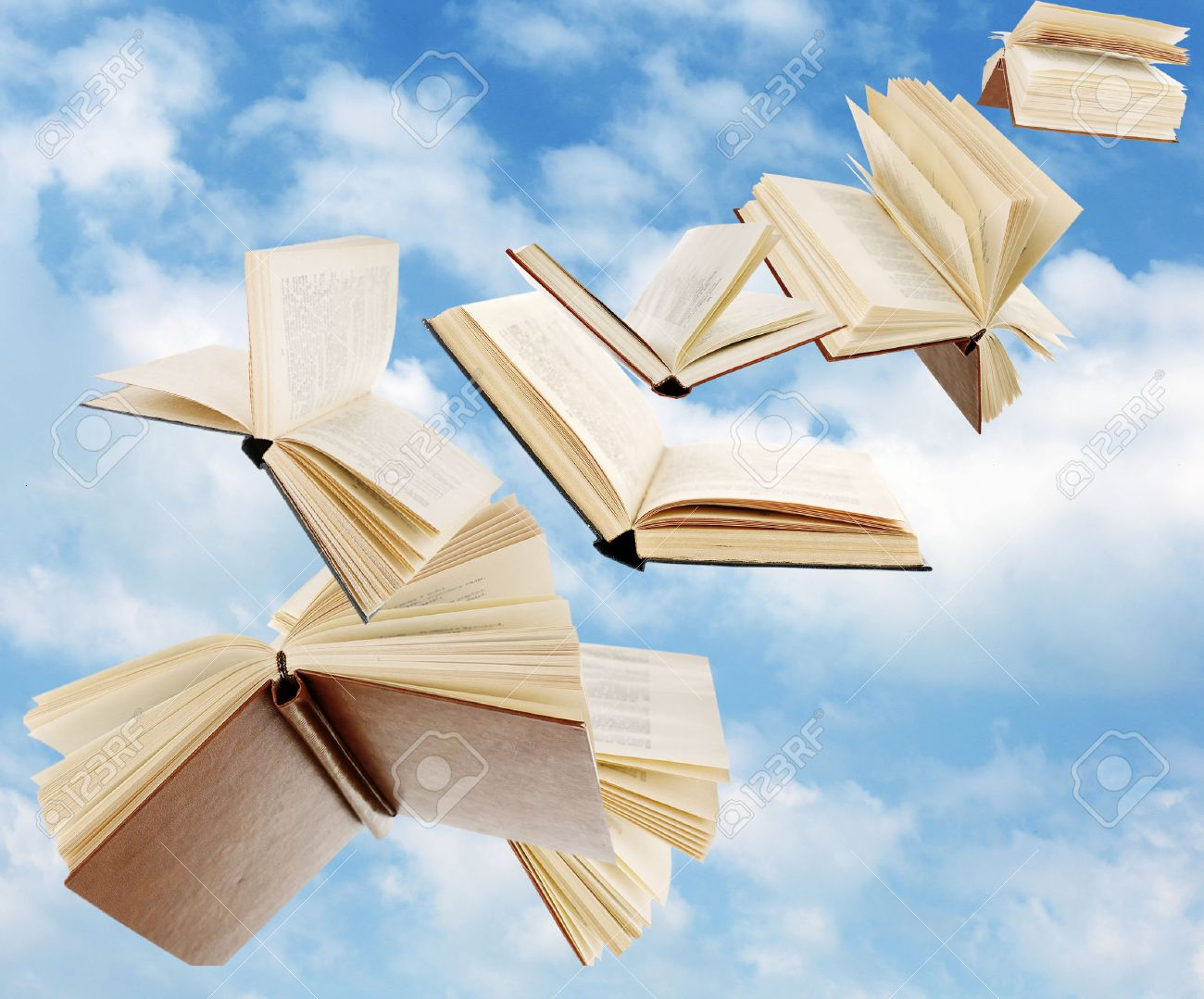 Flying Books On Cloudy Sky Background Stock Photo, Picture And ...
