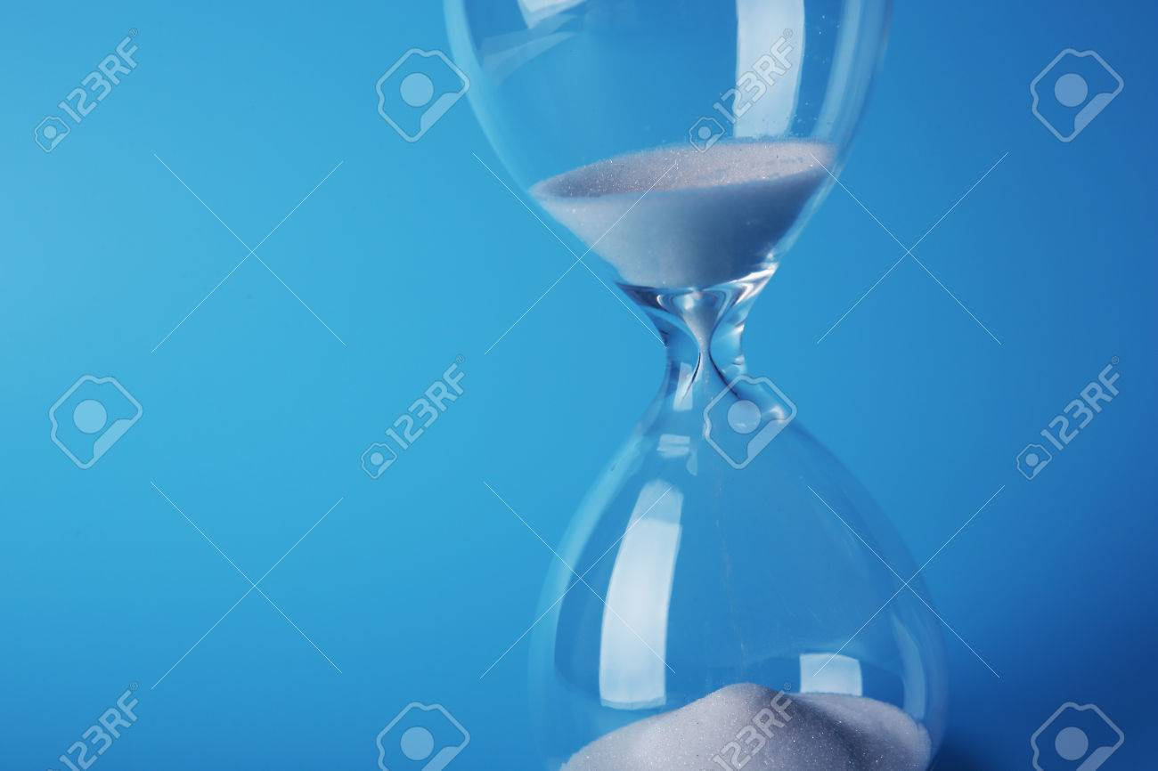 Hourglass on blue background - 53934863