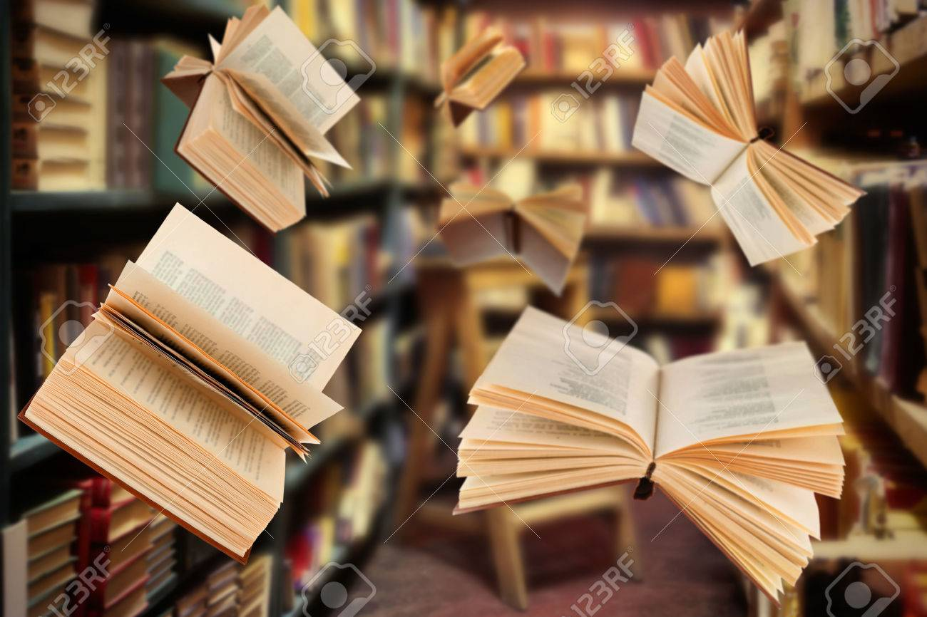flying open books in library stock photo 54510587