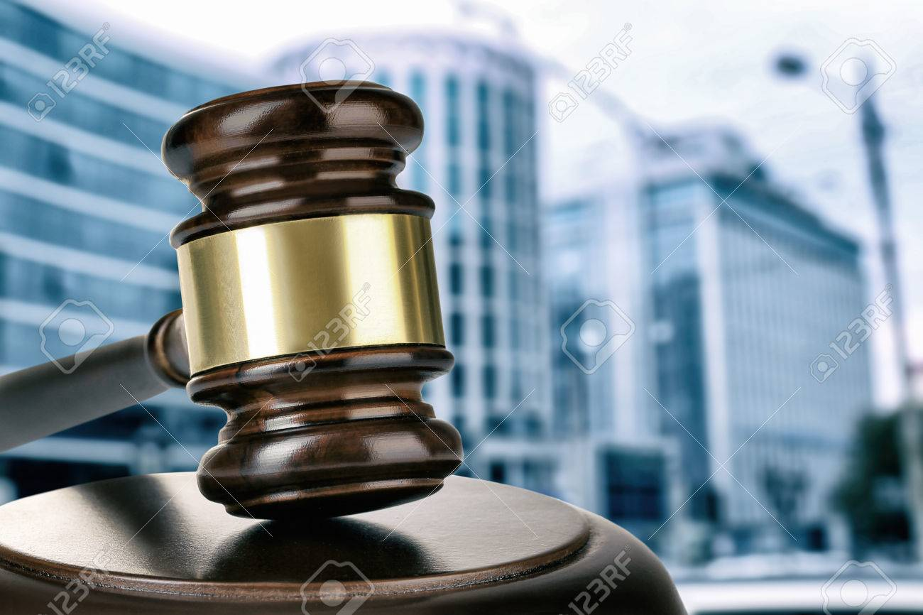 Gavel on building background. Auction concept - 55697586
