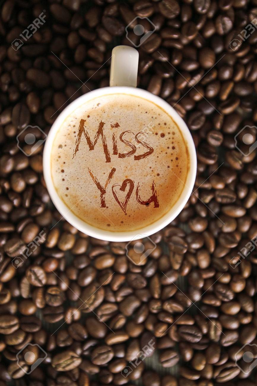 Cup Of Coffee With Words Miss You On Foam Top View Stock Photo