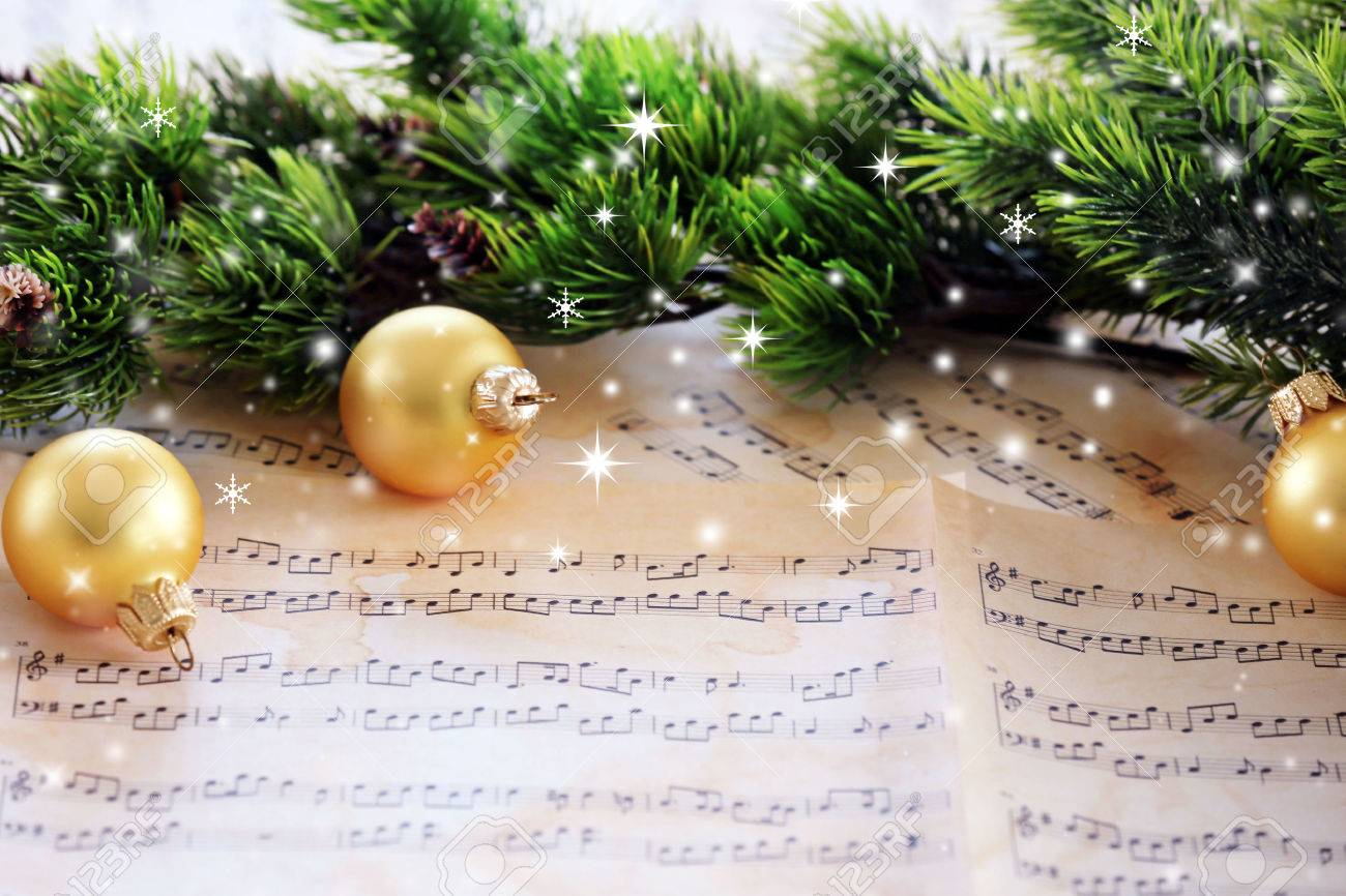 Christmas decorations on music sheets with snow effect - 57510347