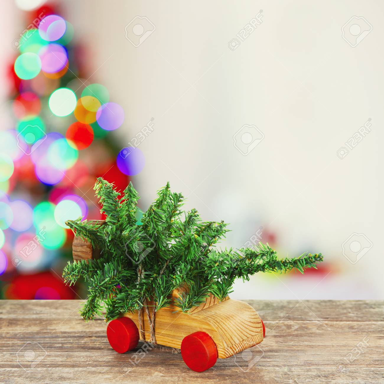 Wooden Toy Car Carrying Christmas Miniature Tree On Shiny Lights ...