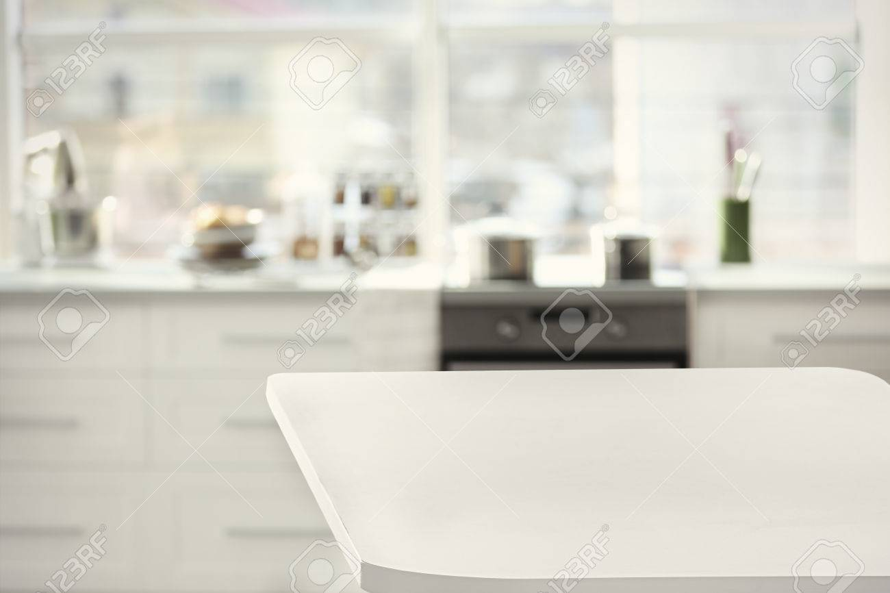 Empty wood table and blurred living room background stock photo - Empty Wooden Table And Blurred Kitchen Background Stock Photo 66921472