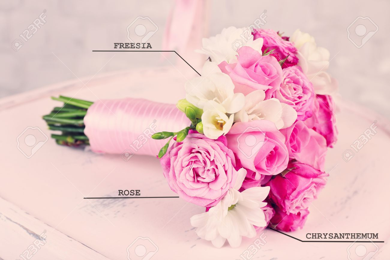 Beautiful Wedding Bouquet With Flowers Names On Wooden Chair Stock