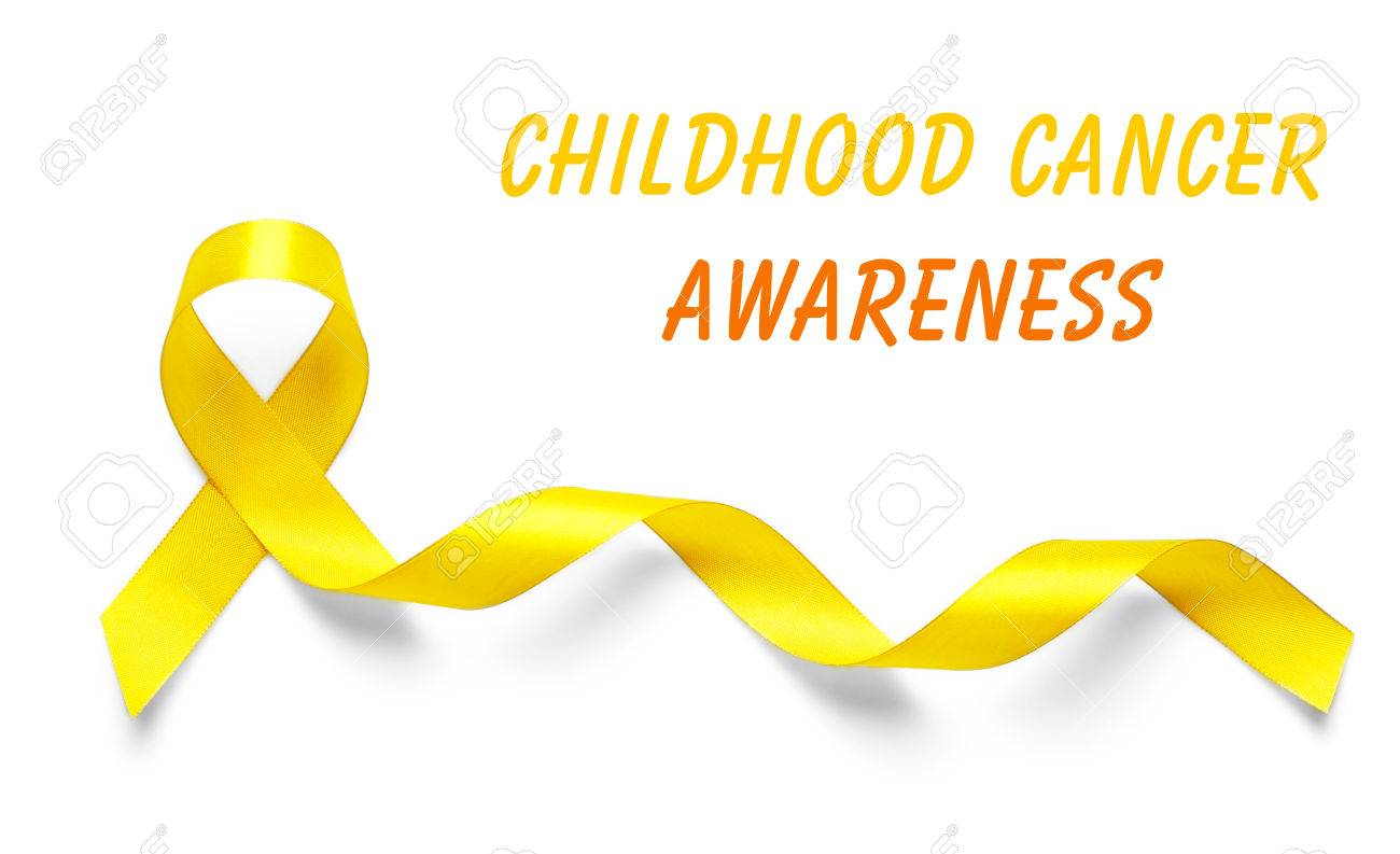 Yellow Ribbon And Text Childhood Cancer Awareness On Light