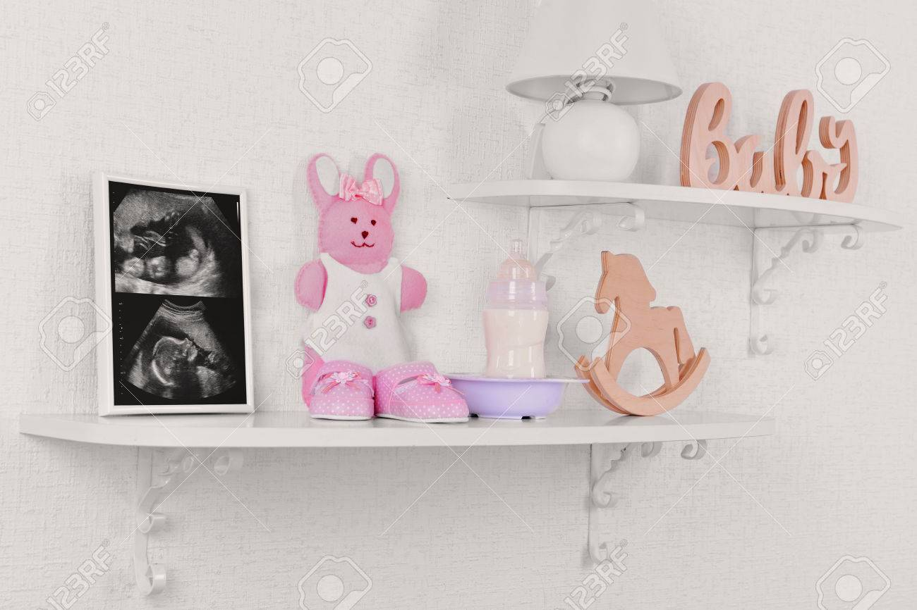 Photo Frame With Ultrasound Scan Of Baby And Accessories On Shelves ...