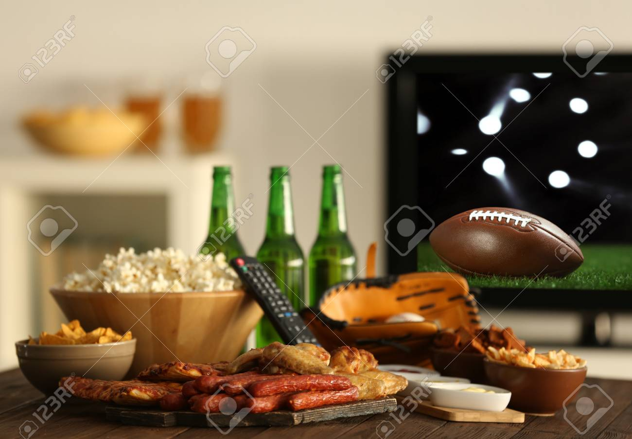 Watching American Football Game On Television At Home Leisure