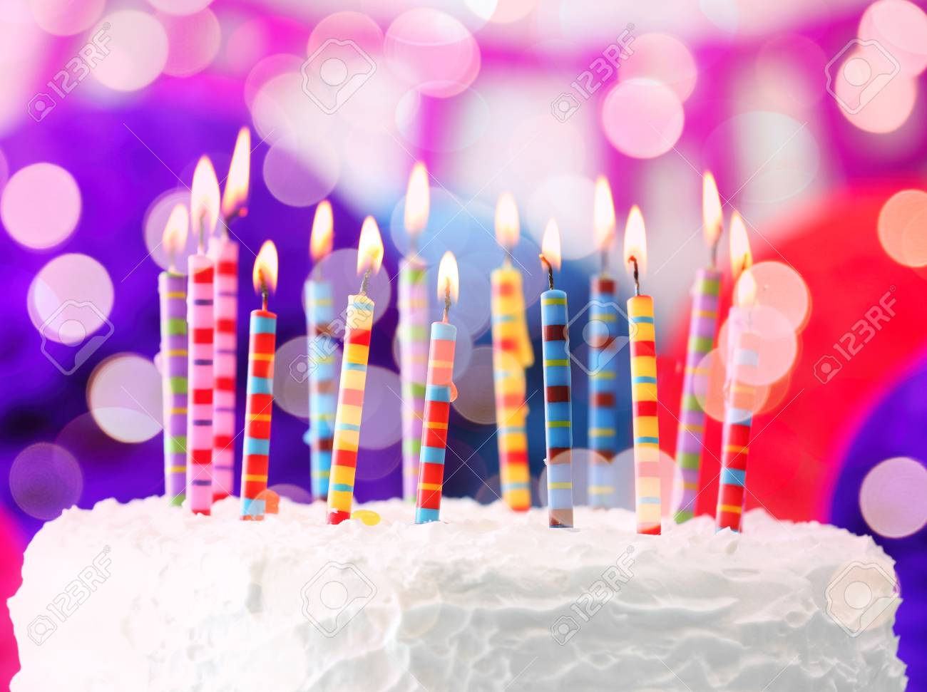 Lighted Candles On Birthday Cake Closeup Stock Photo Picture And Royalty Free Image Image 88596828