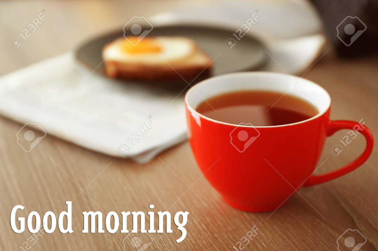 Cup Of Aromatic Tea On Table Text Good Morning On Background Stock