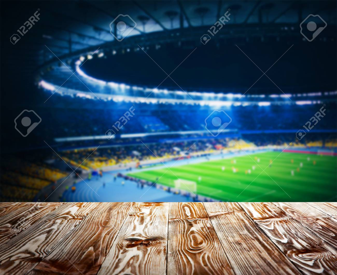 wooden table against football stadium background stock photo picture and royalty free image image 90653846 123rf com