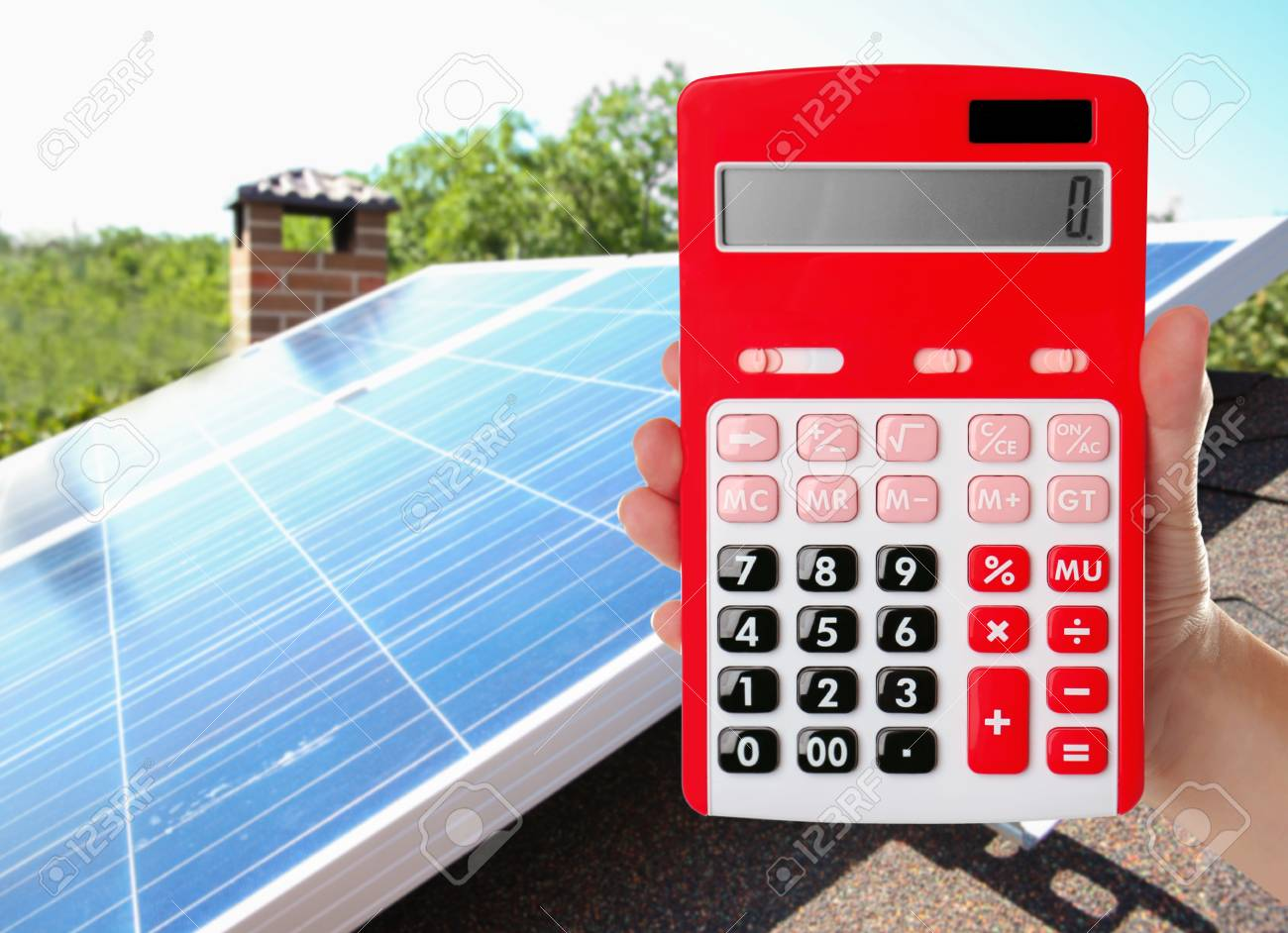 Woman holding calculator and solar panels on background  Reduction