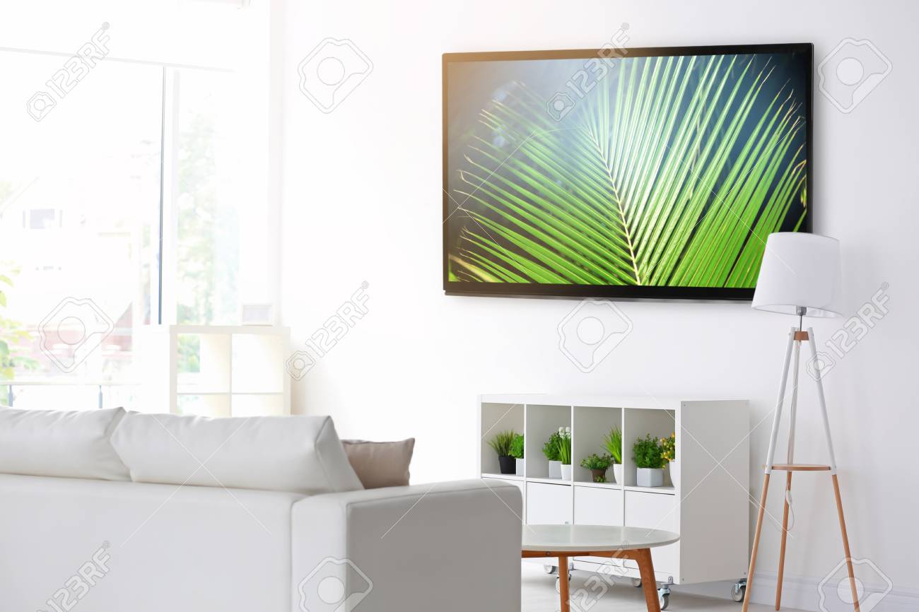 Cozy Interior Of Living Room With Tv On Wall Stock Photo Picture And Royalty Free Image Image 90868009
