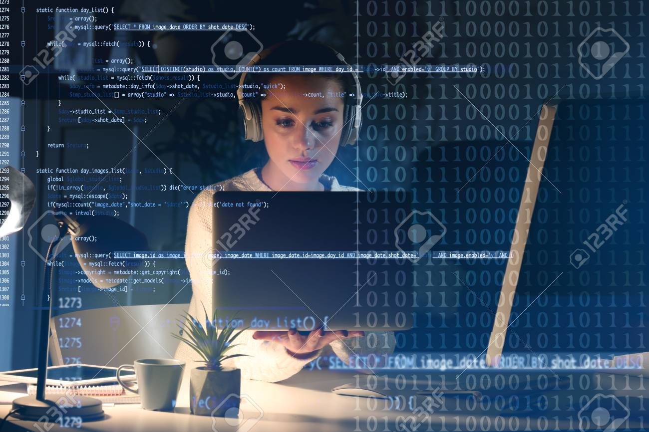Program development concept. Young woman listening to music while working with laptop - 95548722