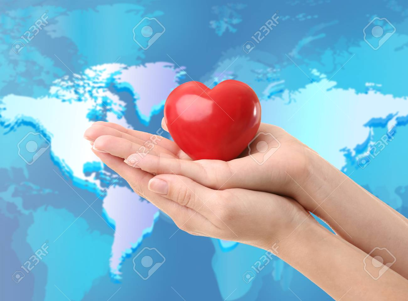 World Map On Hands.Woman Holding Heart In Hands And World Map On Background Earth