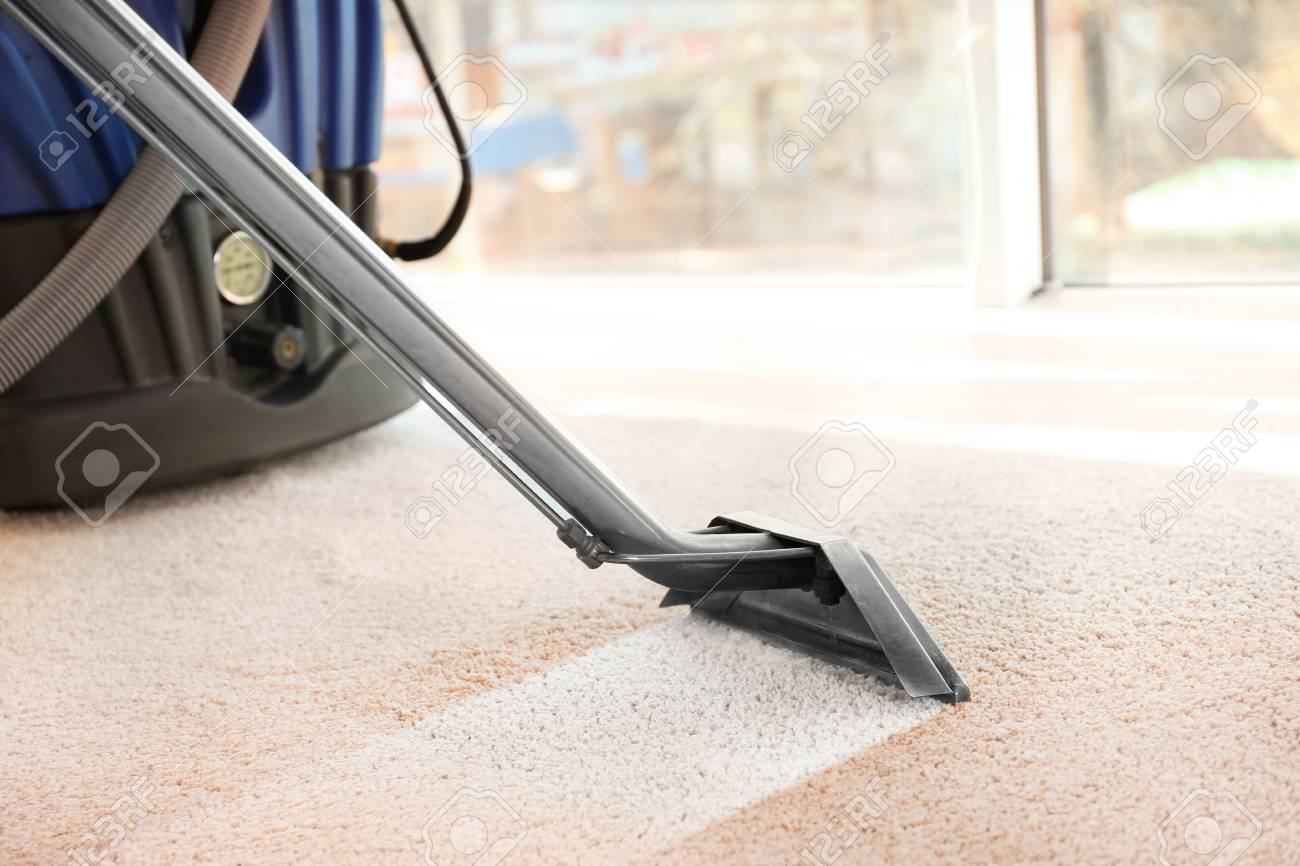 Cleaning service concept. Steam vapor cleaner removing dirt from carpet in flat, closeup - 91620228