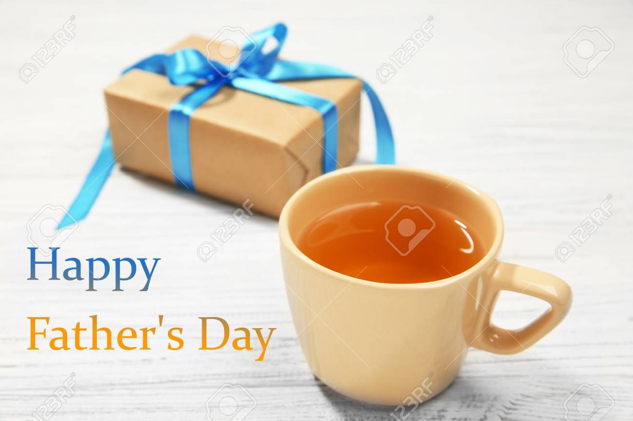 Cup Of Tea Gift Box And Text Happy Father S Day On White Wooden Stock Photo Picture And Royalty Free Image Image 91840232