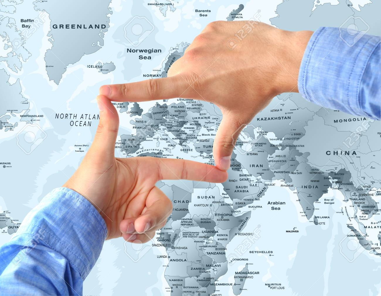 Man Focusing Finger Frame On Western Europe World Map Concept