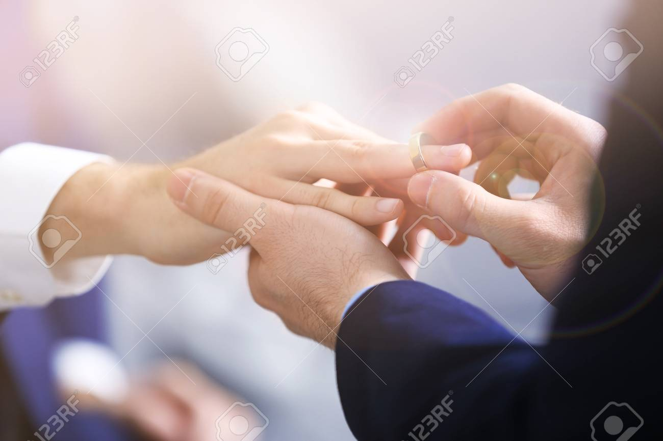 Man Putting Wedding Ring On Groom S Finger Closeup Gay Rights