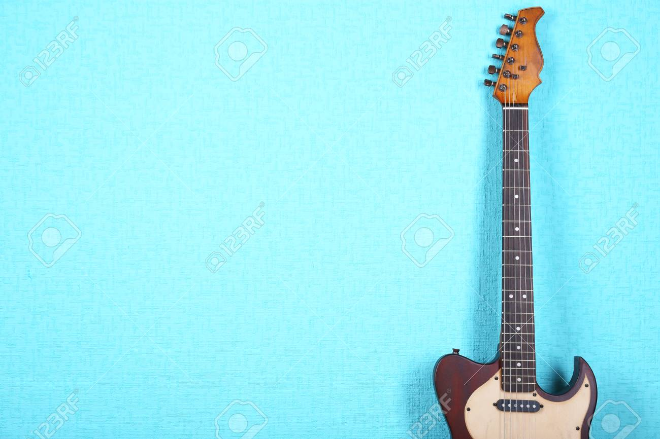 Electric Guitar On Blue Wallpaper Background Stock Photo Picture And Royalty Free Image Image 93481527