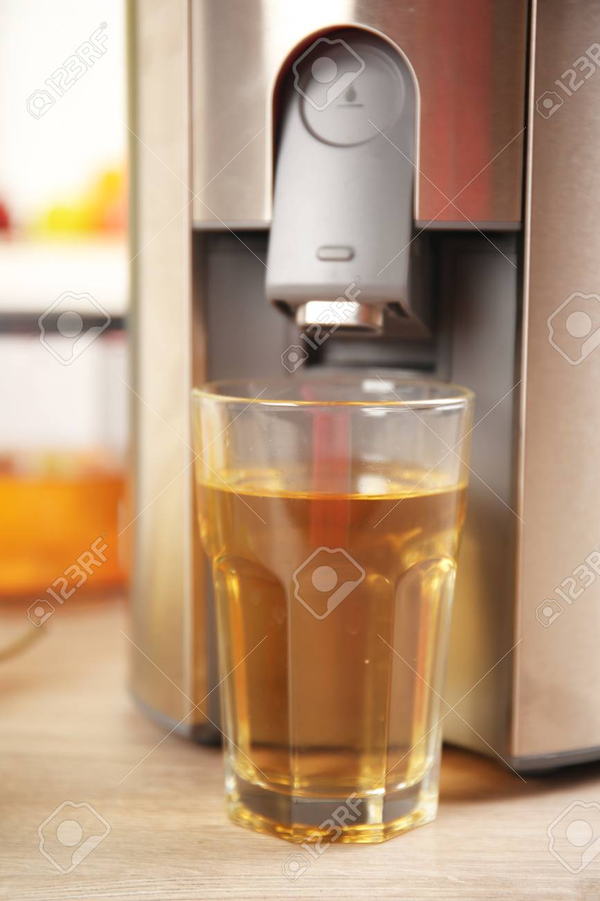 Juicer And Pear Juice On Kitchen Table Stock Photo   94371977